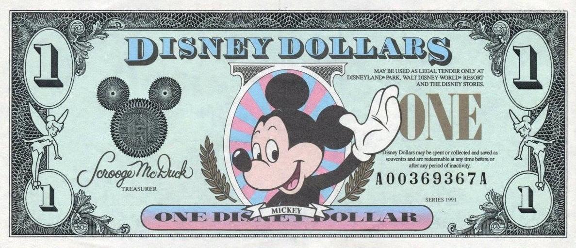 Een biljet van één Disney Dollar